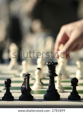 chess board with hand, shallow depth of field
