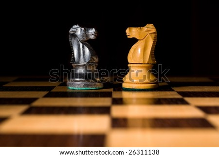 Chess board with 2 knights as example of game or business concept for power, strategy or success