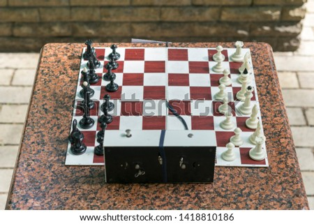 Chess board with pieces and clock on wooden desk In connection with the chess tournament. Chess tournament with chess clock on wooden table #1418810186