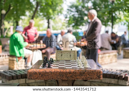Chess board with pieces and clock on wooden desk In connection with the chess tournament. Chess tournament with chess clock on wooden table #1443541712