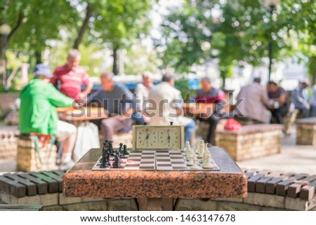 Chess board with pieces and clock on wooden desk In connection with the chess tournament. Chess tournament with chess clock on wooden table #1463147678
