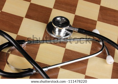 Chess board with stethoscope close-up