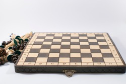 Chess board without pieces. Beginning of the game. Wooden chessboard.