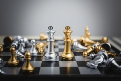 Chess figure king surrounded by falled pawn chess. Business strategy, leadership, success achievement, competition organization concept.
