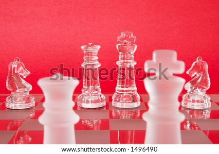 Chess game in glass.  The Queen, King and Knights as seen from the view of the Opposing Queen and King.