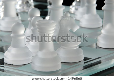 Chess game in white glass.  The Castle, Knight and Pawn.