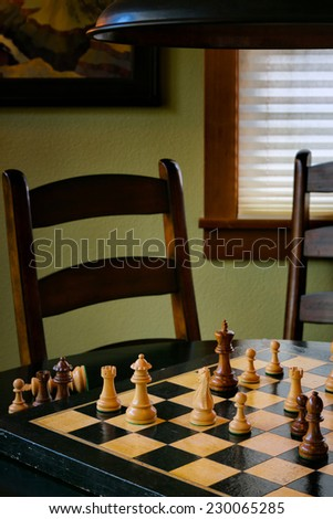 Chess game on a vintage board, with pieces in checkmate position