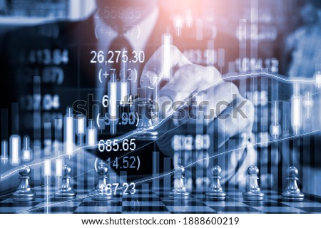 Chess game on chess board behind business man background. Business concept to present financial information and marketing strategy analysis. Investment target in global economy and digital commercial. ストックフォト ©