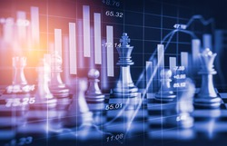 Chess game on chess board behind forex chart indicators or stock market graph in abstract background. Business concept to present financial information and digital marketing strategy analysis.