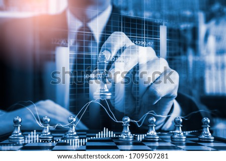 Chess game on chess board on stock market or forex trading graph chart for financial investment concept. Economy trends for digital business marketing strategy analysis. Abstract finance background. Stockfoto ©