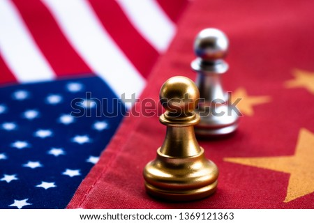 Chess game, two pawn face to face on China and US national flags. Trade war concept. Conflict between two big countries, USA and China concept. Copy space.