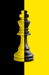 Chess king showing its duality in black and yellow background.