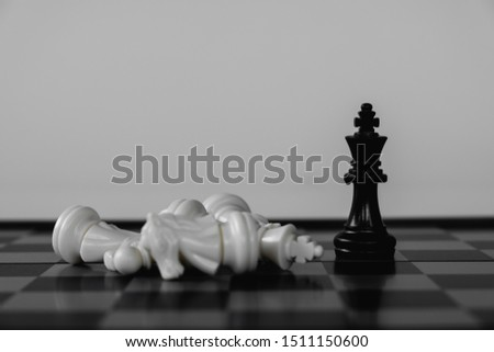 Chess King stand as last winner, victory over the enemies. The winner in business competition. Competitiveness and strategy. #1511150600