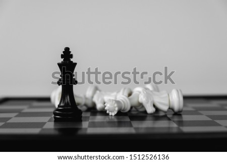 Chess King stand as last winner, victory over the enemies. The winner in business competition. Competitiveness and strategy. #1512526136
