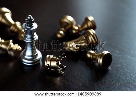 Chess King stand over the enemies. The winner in business competition. Competitiveness and strategy. Copy space.