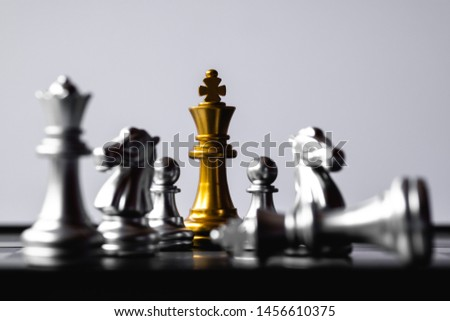 Chess King stand over the enemies. The winner in business competition. Competitiveness and strategy. Copy space. #1456610375