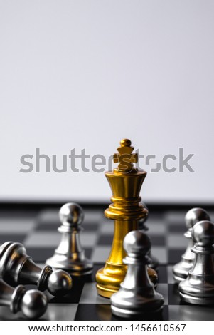 Chess King stand over the enemies. The winner in business competition. Competitiveness and strategy. Copy space. #1456610567