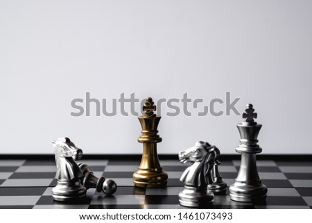Chess King stand over the enemies. The winner in business competition. Competitiveness and strategy. Copy space. #1461073493