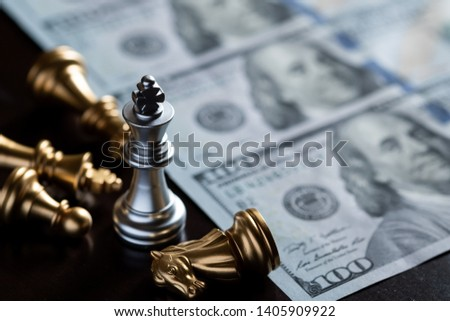 Chess King stand over the enemies with US dollar banknote background. The winner in business competition. Competitiveness and strategy. Copy space.