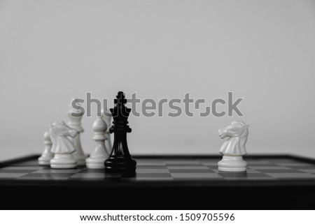 Chess King stand surrounded by enemies. The winner in business competition. Competitiveness and strategy. #1509705596