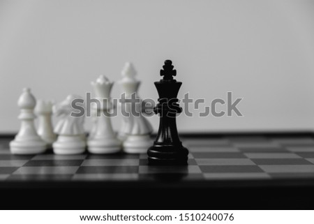 Chess King stand surrounded by enemies. The winner in business competition. Competitiveness and strategy. #1510240076
