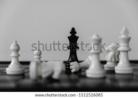 Chess King stand surrounded by enemies. The winner in business competition. Competitiveness and strategy. #1512526085