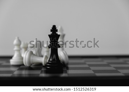 Chess King stand surrounded by enemies. The winner in business competition. Competitiveness and strategy. #1512526319