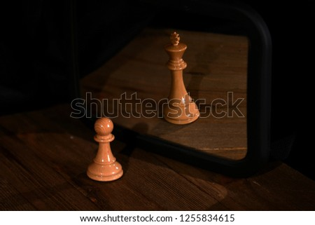 Chess pawn and queen black background #1255834615
