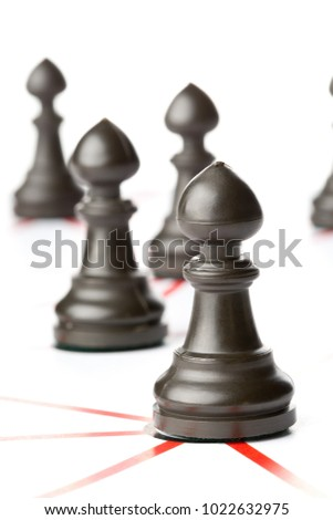 Chess pawn figures connected by red lines over white background - teamwork, connections or social network concept #1022632975