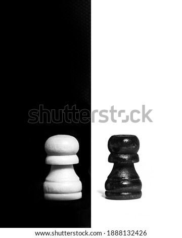 Chess pawns contrasting isolated on black and white background. Visualisation of contrast. Splitted in half   Photo stock ©