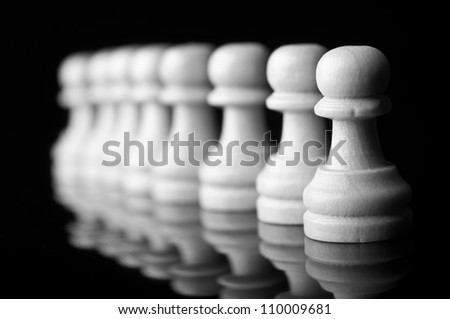 chess pawns isolated on black background