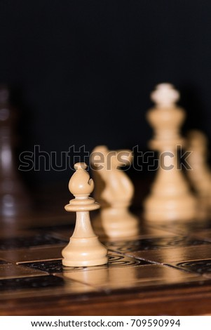 Chess photographed on a chess board #709590994