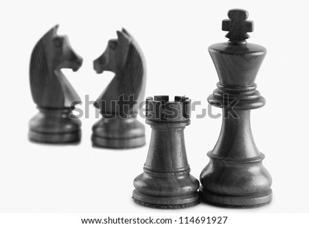 Chess pieces against a white background