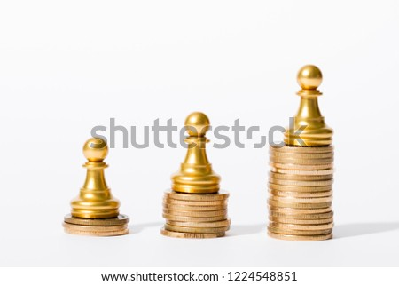 Chess pieces and gold coins, wealth growth and career success, achievement, economic status and social achievement