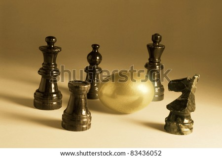 Chess Pieces and Golden Egg in Warm Tone