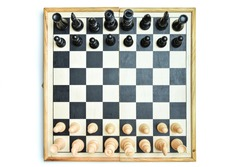 Chess pieces are placed to start the game on the chessboard, above view. Chess pieces on chessboard top view. Game for the mind. Intelligent board games.