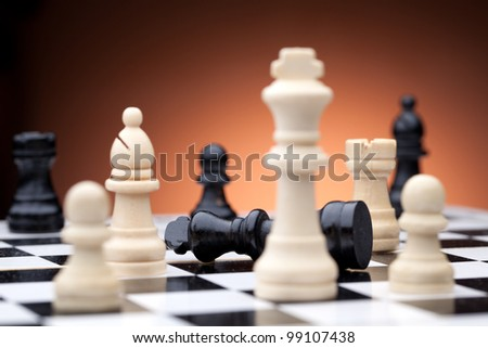 Chess pieces. Focused on black king