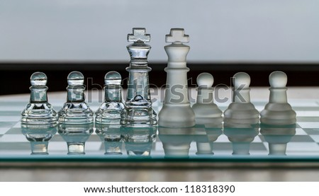 Chess Pieces - King and pawns as business concept - merge / merger.