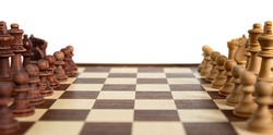 Chess pieces lined up on the chessboard. Concept picture concerning decision making and strategy.