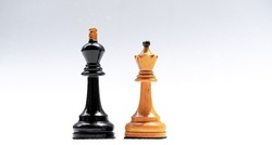 Chess pieces of king and queen on a white background