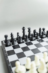 Chess pieces on a chessboard. Black and white. Board game, sports