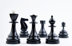 Chess pieces on a white background. Board logical antagonistic game. Intellectual sports.