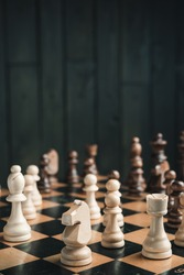 chess pieces on black wood background