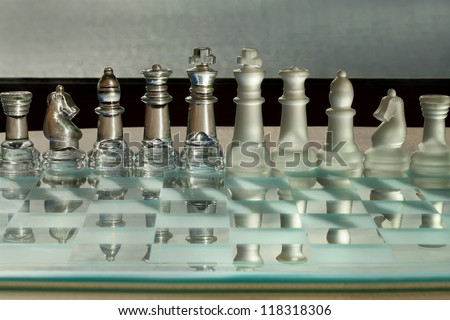 Chess Pieces with Reflections - business concept - strategy, meeting, merger, team, company, corporation.