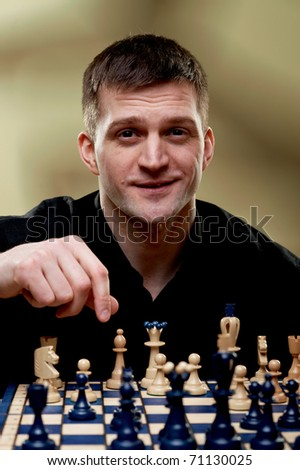 Chess player at a chess board