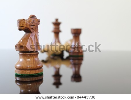 Chess scene on a smoked glass table.