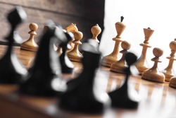 Chess set on the chess board. With selective focus on white pieses.