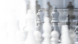 Chess strategic business plan on businesspeople background