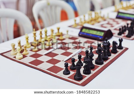 Photo of  Chess tournament boards ready with chess clock chairs and tables