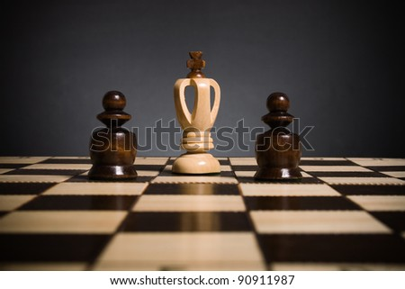 Chess.Two black pawns against the white king.